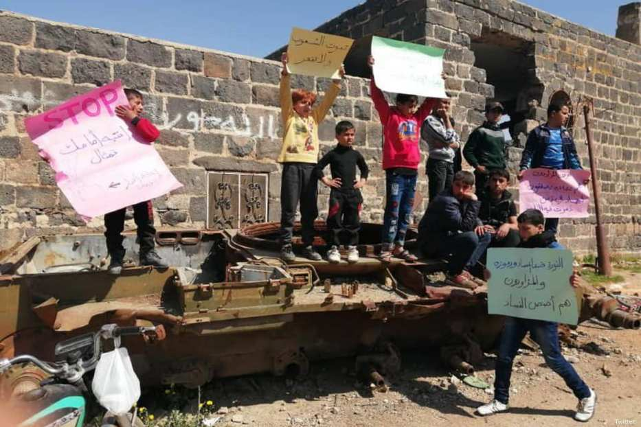 Syrian children protest against the Syrian President Bashar Al-Assad in Daraa, Syria on 10 March 2019