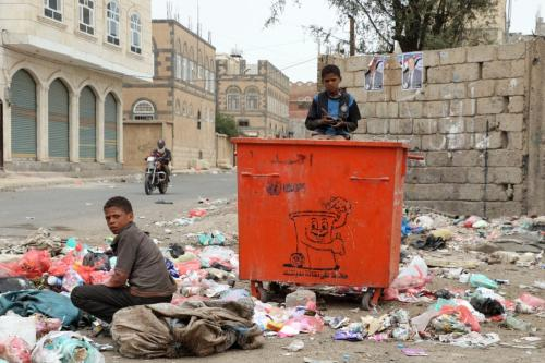 Despite cholera outbreak, Yemeni kids collect garbages form piles of rubbish for recycling in Sana'a, Yemen on 1 April 2019. [Mohammed Hamoud - Anadolu Agency]