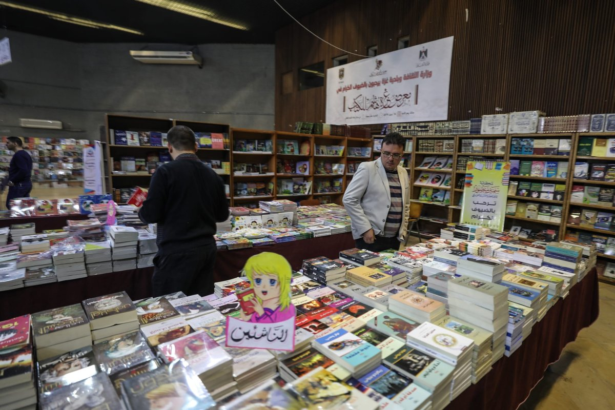 "Palestinians visit the Rashad Al Shawwa Cultural Center during ""Gazzetu Hashim"" book fair, which was opened in despite of limited conditions due to Israeli blockade, in Gaza City, Gaza on 14 April 2019. More than 10 establishment and publishing houses participated in the fair [Mustafa Hassona/Anadolu Agency]"