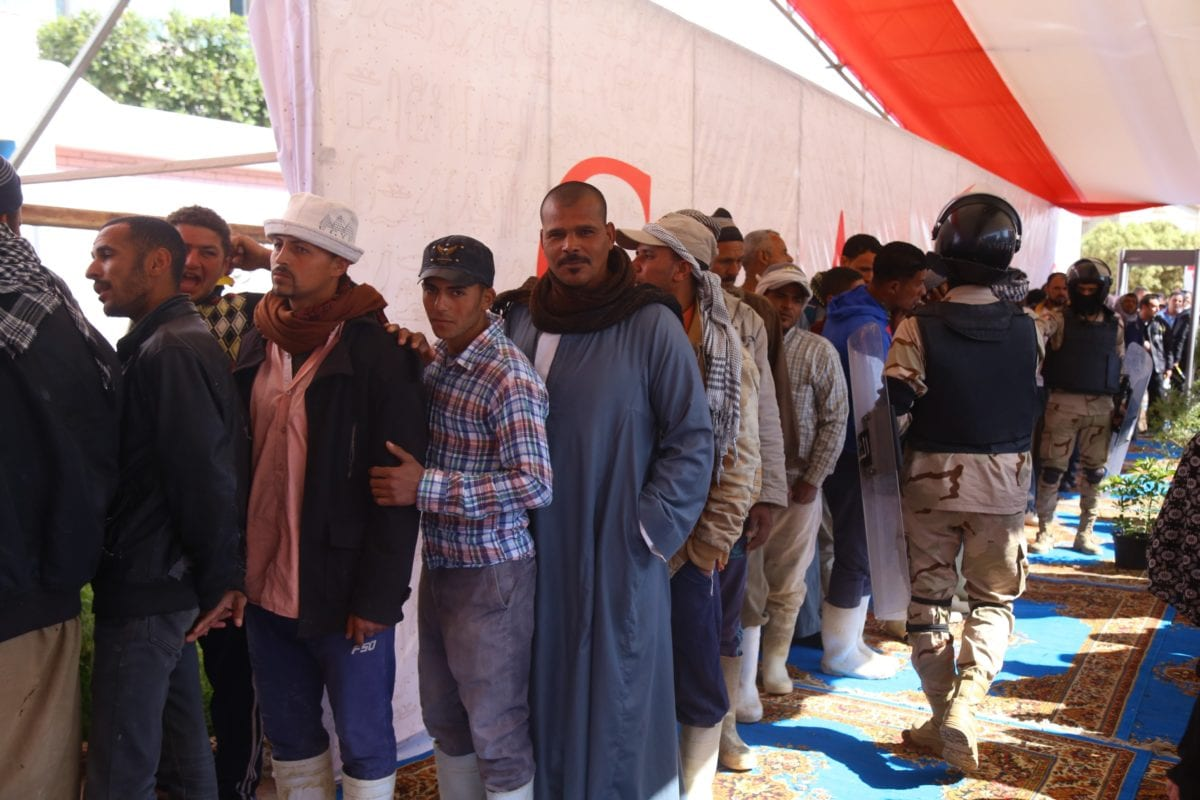 Egyptian voters wait in line to cast ballot at a polling station in a referendum on constitutional amendments which may allow incumbent President Abdel-Fattah al-Sisi to stay in power until 2030, on April 20, 2019 in Cairo, Egypt. [Stringer - Anadolu Agency]