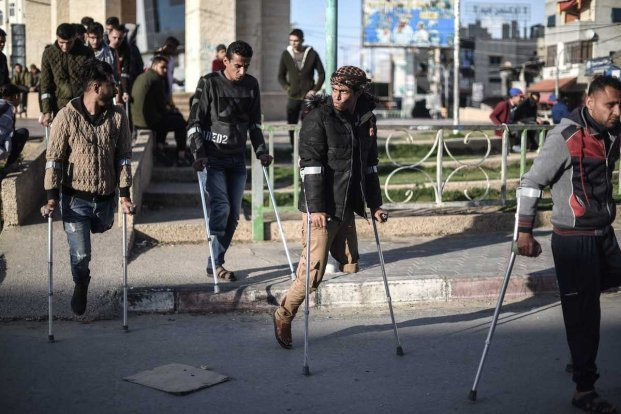 "RAFAH, GAZA - APRIL 21: Handicapped Palestinians, who lost their limbs during the excessive interventions of Israel towards ""Great March of Return"" demonstrations, stage a demonstration at Unknown Martyrs Square demanding prosthesis legs, medications and better living conditions in Rafah, Gaza on April 21, 2019. ( Abed Zagout - Anadolu Agency )"