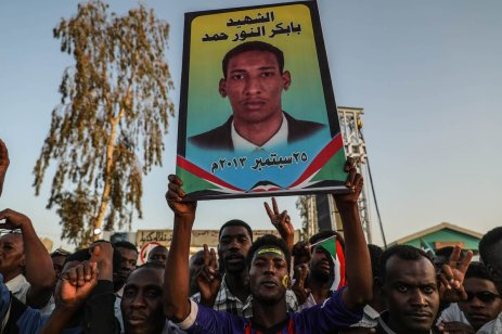 KHARTOUM, SUDAN - APRIL 21: Sudanese demonstrators gather in front of military headquarters during a demonstration after The Sudanese Professionals Association's (SPA) call, demanding a civilian transition government, in Khartoum, Sudan on April 21, 2019. Demonstrators hold photos of people who lost their lives on the protests. ( Mahmoud Hjaj - Anadolu Agency )