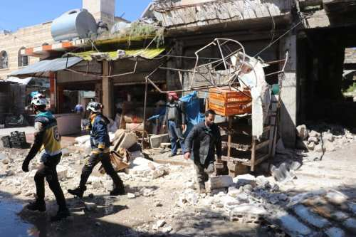 White Helmets members remove the wreckage after Assad Regime's army hit a market place in 'Saraqib district of Idlib, Syria on April 22, 2019. ( Hüseyin Fazıl - Anadolu Agency )