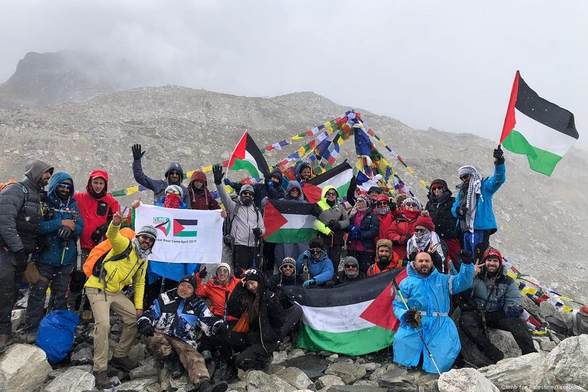 A group of Palestinians has reached the base camp of Mount Everest, flying the Palestinian flag in celebration [Climb for Palestine/Facebook]