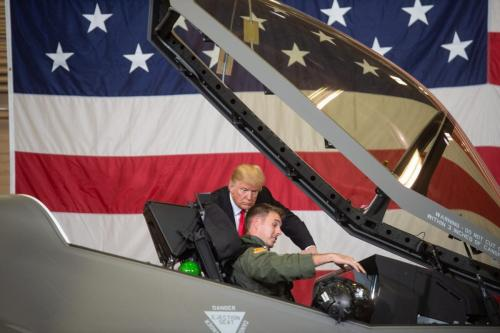 """US President Donald Trump speaks with F-35 fighter plane pilot Lt Col Jason Curtis as he tours Luke Air Force Base in Phoenix, Arizona where he is for a """"Make America Great"""" rally on 19 October 19, 2018 [NICHOLAS KAMM/AFP/Getty]"""