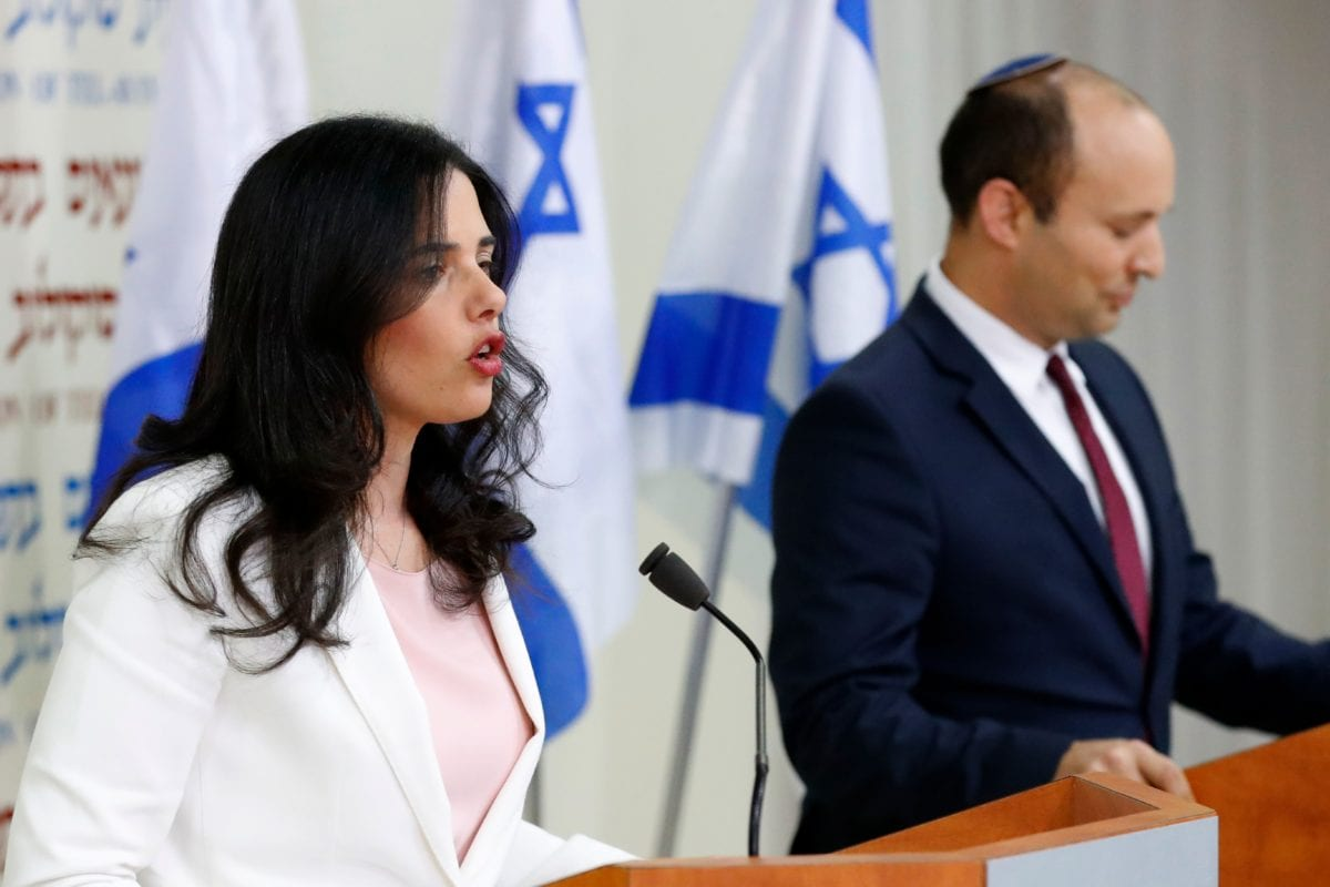 Israel's Minister of Education Naftali Bennett (R) and Israeli Justice Minister Ayelet Shaked (L) announce the formation of new political party HaYemin HeHadash or The New Right, during a press conference in the Israeli Mediterranean coastal city of Tel Aviv on 29 December 2018. [JACK GUEZ / AFP / Getty]
