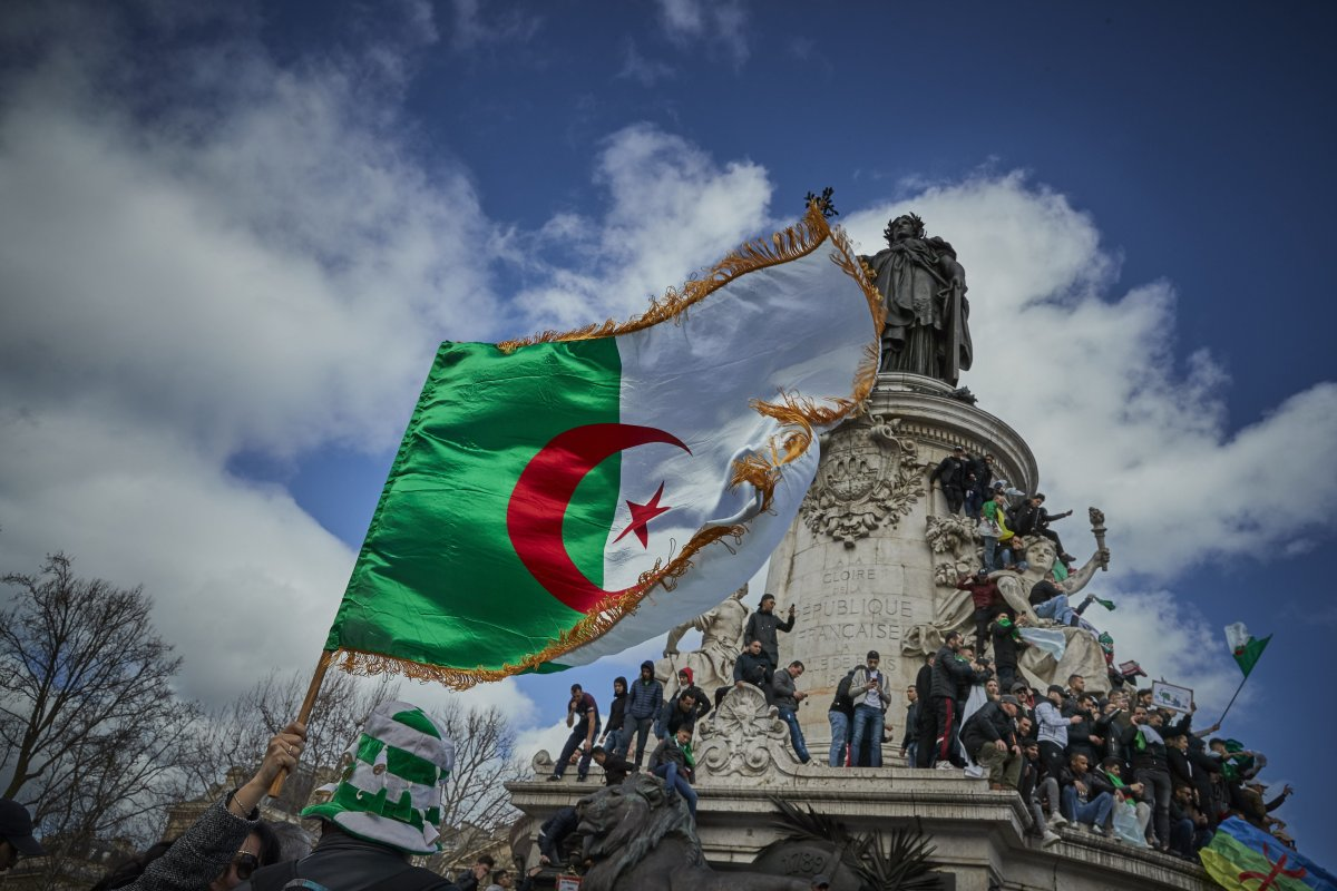 French Algerians wave the Algerian flag in protest against a fifth presidential term of President Abdelaziz Bouteflika on 10 March 2019 [Kiran Ridley/Getty Images]