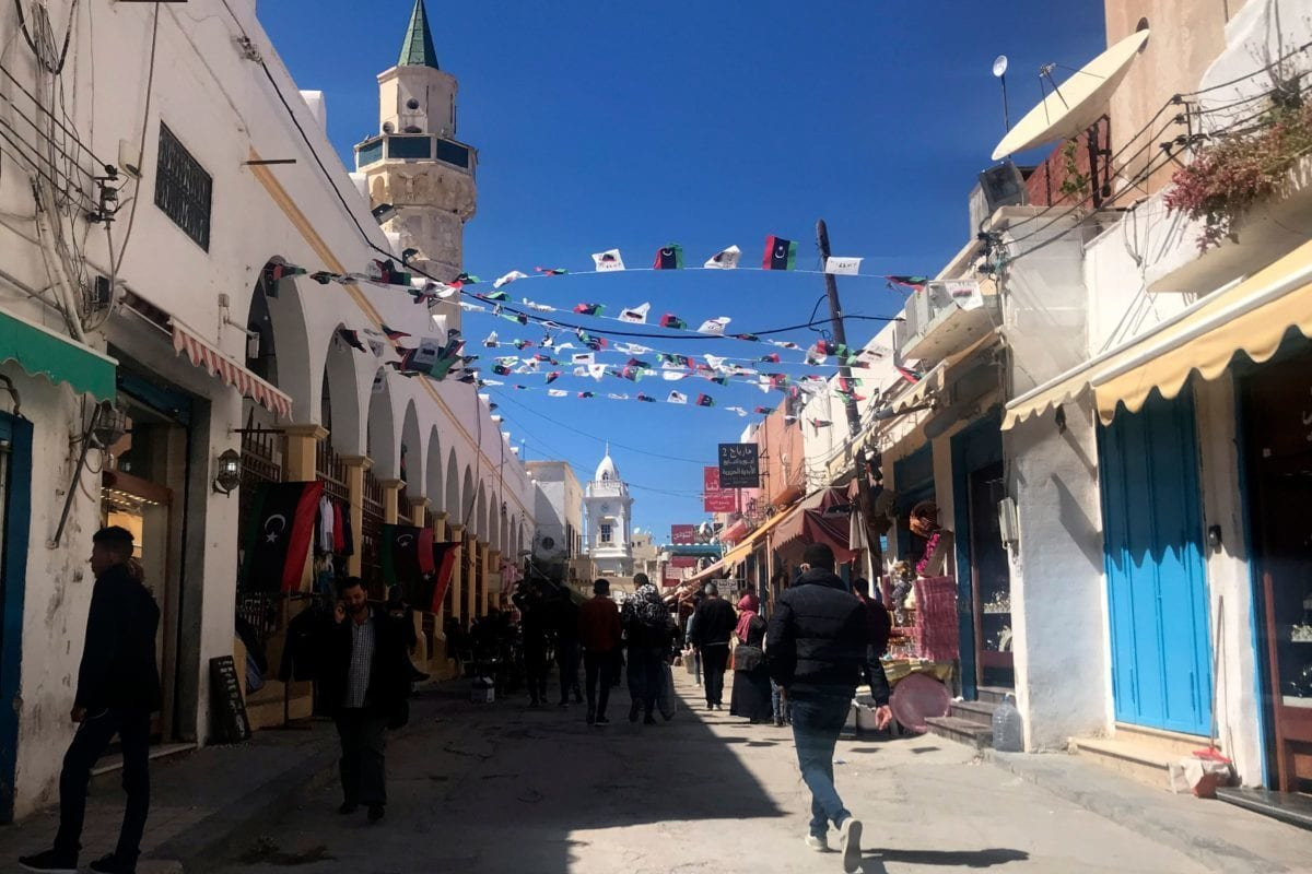 Libyans walk through a market road near the Libyan capital Tripoli's Martyr Square on April 6, 2019. - Anti-government forces led by Libyan strongman Khalifa Haftar said Saturday they had been targeted by an air strike about 50 kilometres (30 miles) south of Tripoli. [Mahmud TURKIA / AFP / Getty]