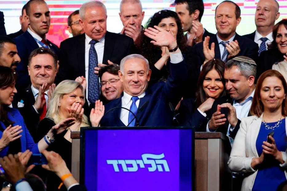 Israeli Prime Minister Benjamin Netanyahu (C) waves to supporters at his Likud Party headquarters in the Israeli coastal city of Tel Aviv on election night early on 10 April 2019. [Thomas COEX / AFP /Getty Images]