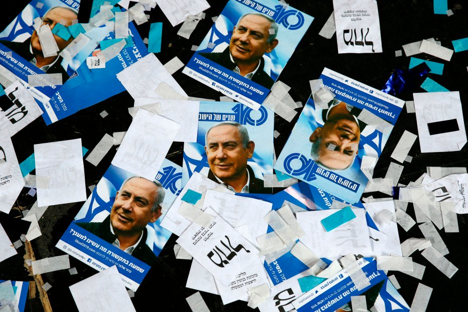 This picture taken early on April 10, 2019 shows Israeli Likud Party campaign material and posters of Prime Minister Benjamin Netanyahu strown on the floor following election night at the party headquarters in the coastal city of Tel Aviv. (Photo by Jack GUEZ / AFP / Getty)