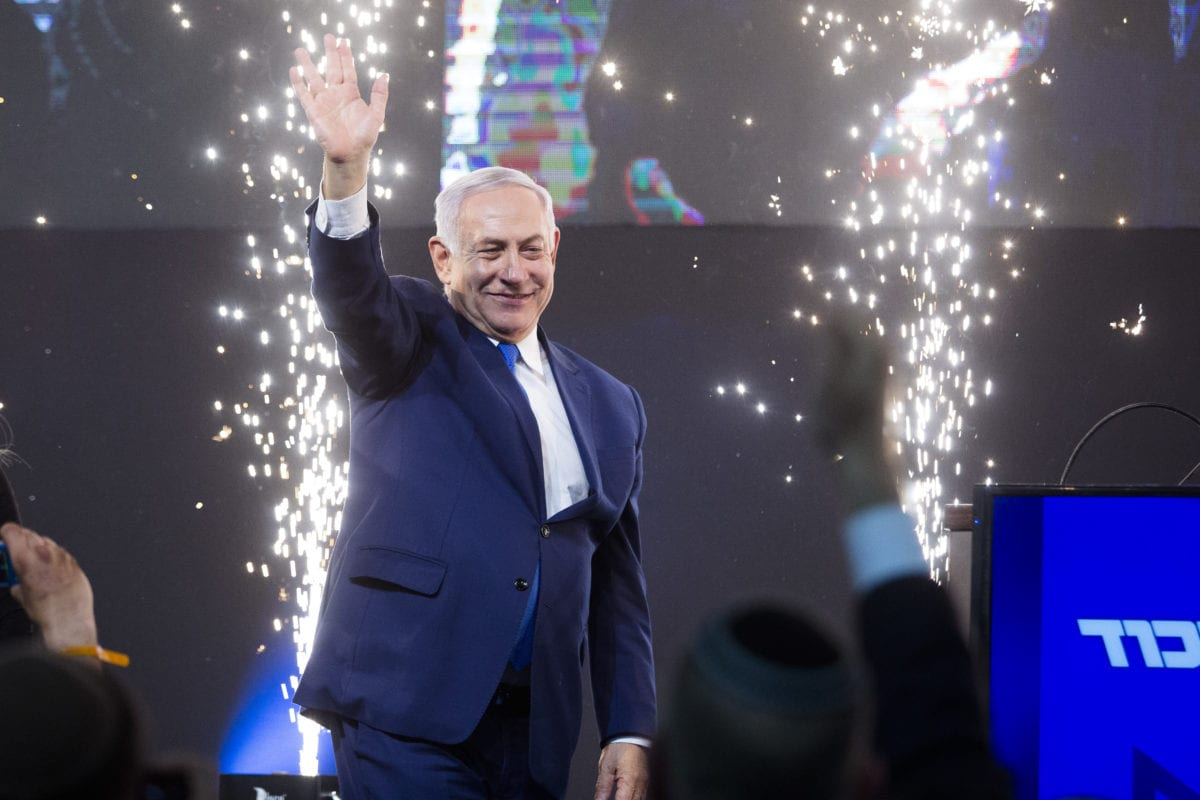 Prime Minster of Israel, Benjamin Netanyahu greets supporters on 10 April, 2019 in Tel Aviv, Israel [Amir Levy/Getty Images]
