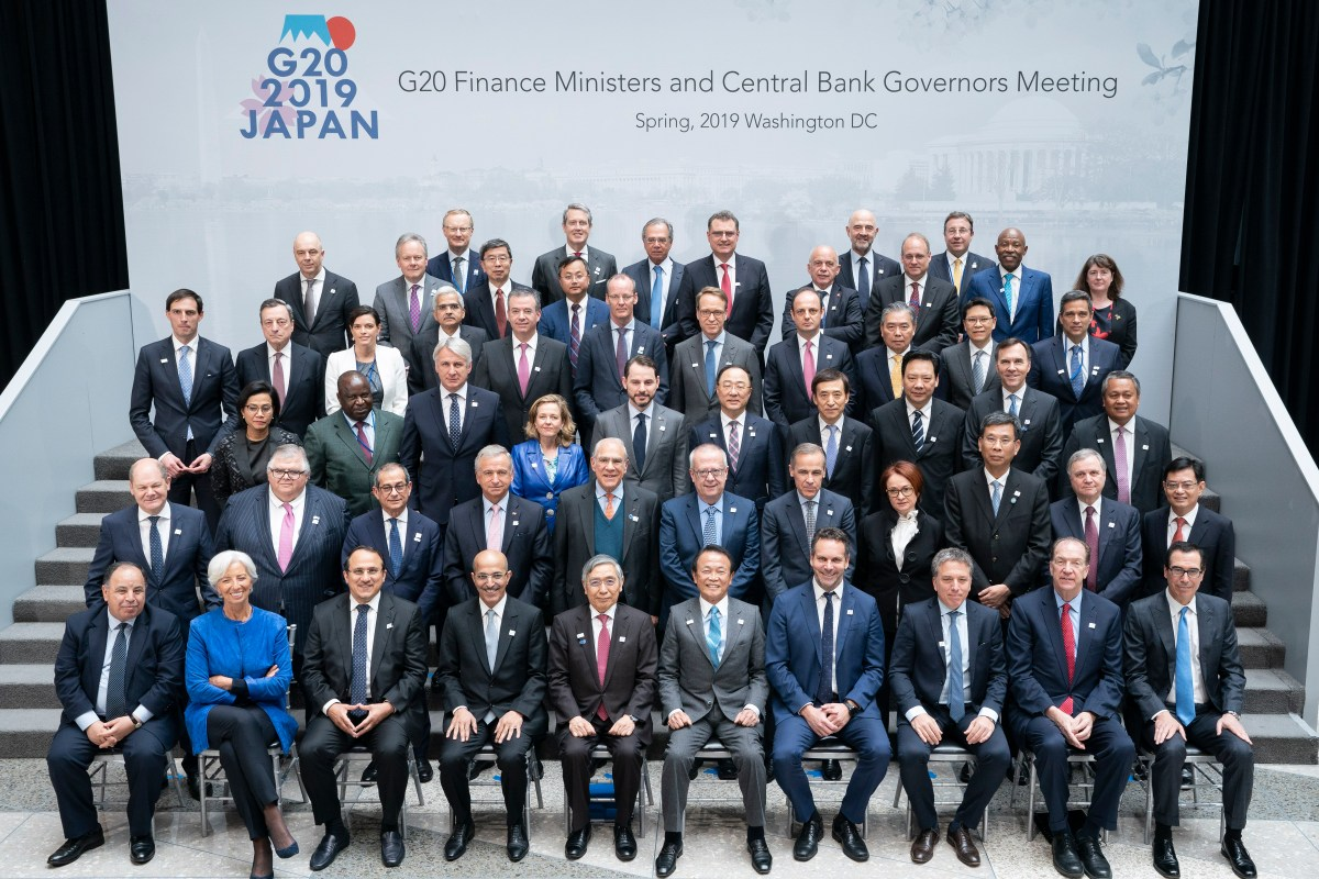 In this IMF handout, the G20 Finance Ministers and Central Bank Governors pose for a formal family photo at IMF Headquarters during the 2019 IMF/World Bank Spring Meetings 12 April, 2019 in Washington, DC [Stephen Jaffe/IMF via Getty Images]