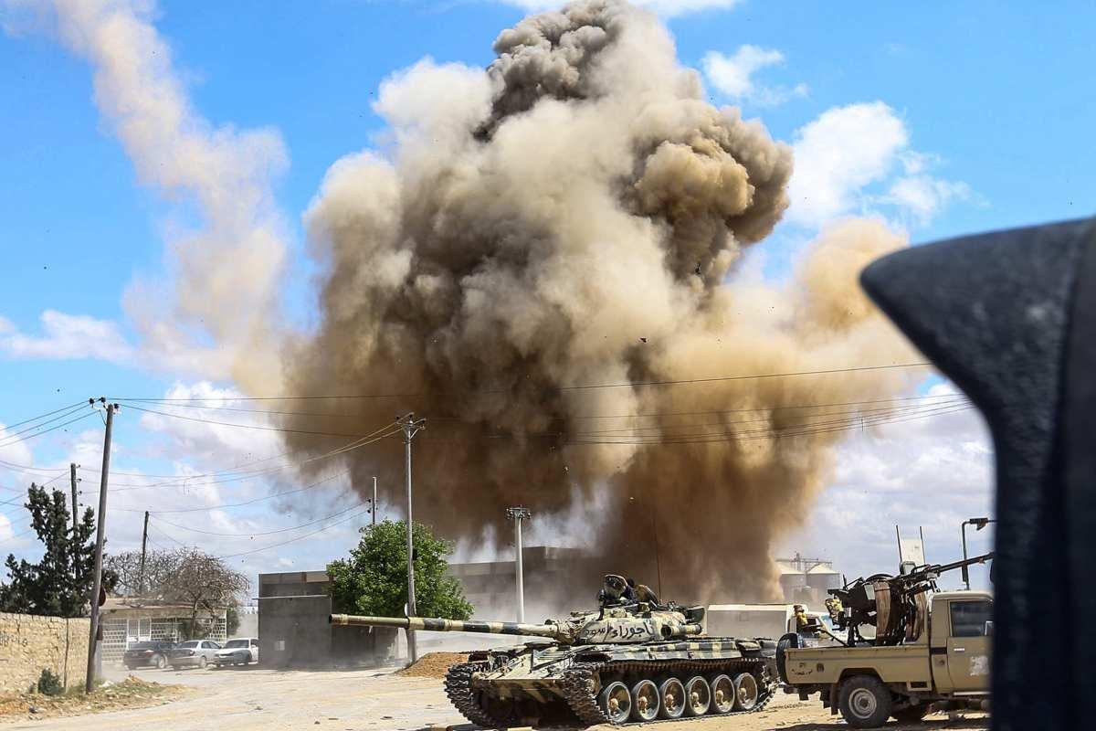 Smoke plume rising from an air strike in Libya [Mahmud TURKIA/AFP/Getty]