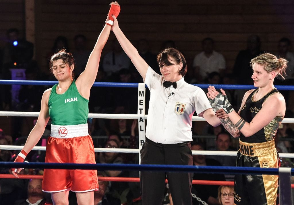 Iran's Sadaf Khadem (L) is designated as winner at the end of her amateur 3 rounds boxing match against France's Anne Chauvin (R) on 13 April 2019 in Royan, western France. [MEHDI FEDOUACH/AFP/Getty Images]