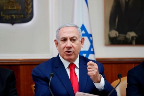 Israeli Prime Minister Benjamin Netanyahu speaks during the weekly cabinet meeting in Jerusalem on 14 April, 2019 [RONEN ZVULUN/AFP/Getty Images]