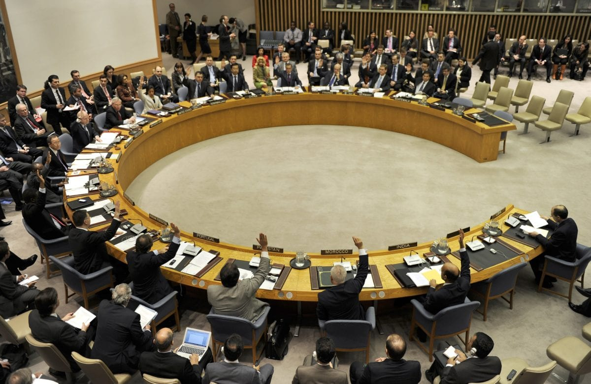 Members of the United Nations Security Council vote to extends its political mission in Libya with a mandate to promote democracy during a meeting on Libya and the Middle East situation 12 March 2012. [AFP PHOTO/ TIMOTHY A. CLARY / Getty]