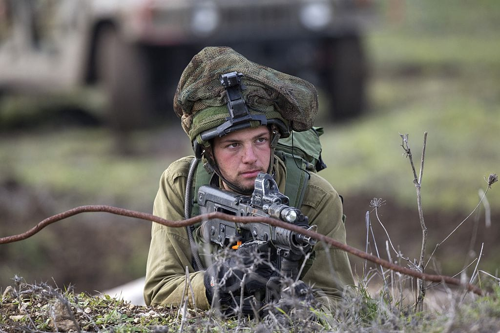 Israeli soldiers from the Golani Brigade take part in a military training exercise in the Israeli-annexed Golan Heights near the border with Syria on 19 January, 2015 [JACK GUEZ/AFP/Getty Images]