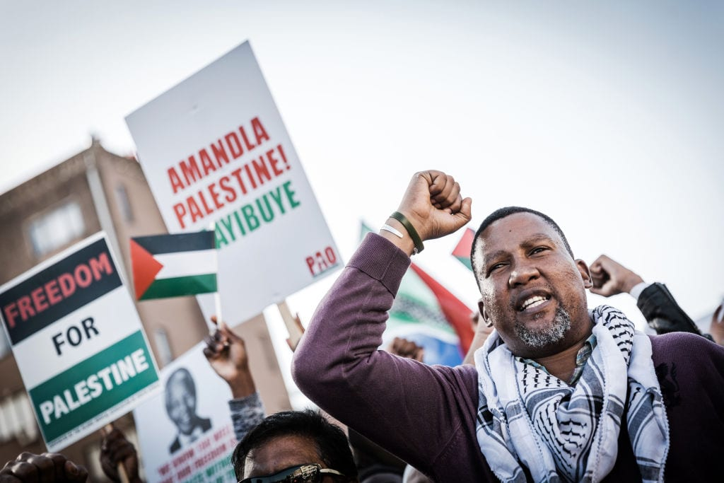 Former South African President Nelson Mandela's grandson, Chief Mandla Mandela joins hundreds of demonstrators at an inter-denominational march of members of pro-Palestinian groups and other civil society organisations during the holy month of Ramadan in Durban on June 2, 2018, to protest against Israel's handling of protests and violence in the Palestinian territories. [RAJESH JANTILAL/AFP/Getty Images]