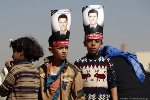 Yemeni boys attend the funeral of a Yemeni journalist Almigdad Mojalli who was was killed in an air raid by the Saudi-led coalition on 18 January 2016 [MOHAMMED HUWAIS/AFP/Getty Images]