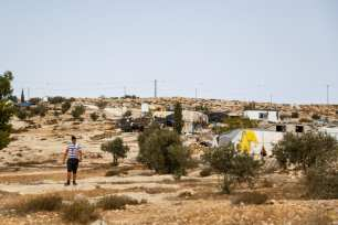 16-year-old Oudi walks through his home village of Susiya, one day he hopes to become an electrician