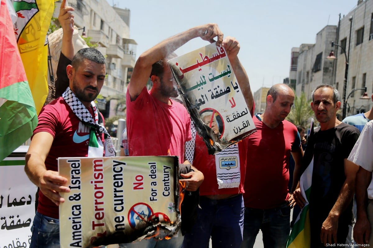 Palestinians stage a protest against the 'Deal of the Century', planned by US President Donald Trump to solve the conflict between Palestine and Israel, in Ramallah, West Bank on 2 July 2018 [Shadi Hatem/Apaimages]