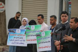 GAZA CITY, GAZA - MAY 05 : Journalists hold placards during a demonstration to protest Israeli attack towards Anadolu Agency's office after it was hit by Israeli warplanes' in Gaza 05, 2019. Israeli warplanes hit the building with at least 5 rockets after warning shots, Anadolu Agency's correspondent in Jerusalem reported. ( Mustafa Hassona - Anadolu Agency )