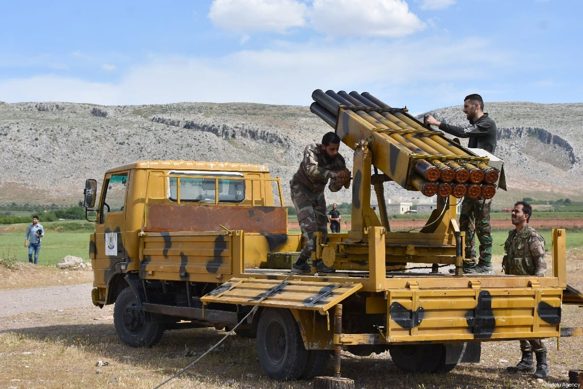 Free Syrian Army (FSA) members make last preparations to fire a missile to hit the points of Assad regime and terror groups in Aleppo to retaliate against YPG/PKK attacks in Idlib de-escalation zone, on 9 May 2019, Aleppo, Syria. [Hişam el Homsi - Anadolu Agency]
