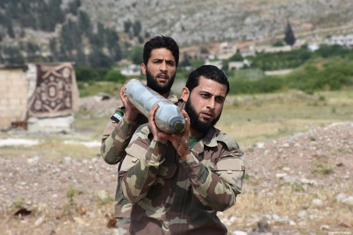 Free Syrian Army (FSA) members make last preparations to fire a missile to hit the points of Assad regime and terror groups in Aleppo to retaliate against YPG/PKK attacks in Idlib de-escalation zone, on May 09, 2019, Aleppo, Syria. ( Hişam el Homsi - Anadolu Agency )