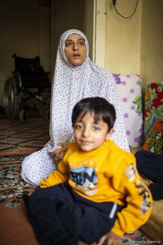 23-year-old Syrian Ayse Halo Ajouri (back), living in Syria's Aleppo with her two children Muhammed and Husein (front), is seen during an exclusive interview in Ankara, Turkey on 8 May, 2019 [Özge Elif Kızıl/Anadolu Agency]