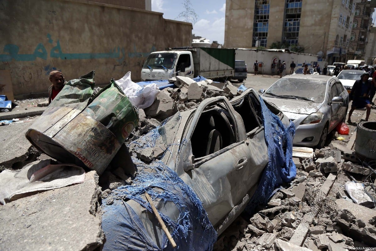 Wrecked vehicles are seen after an airstrike carried out by a Saudi-led military coalition in Sanaa, Yemen on May 16, 2019. [Mohammed Hamoud - Anadolu Agency]