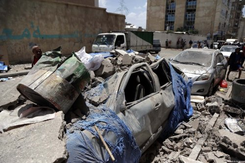 Wrecked vehicles are seen after an airstrike carried out by a Saudi-led military coalition in Sanaa, Yemen on 16 May, 2019 [Mohammed Hamoud/Anadolu Agency]