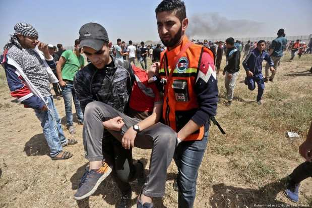 Israeli forces fire at Palestinians while taking part in peaceful protests to commemorate 71 years since the Nakba on 15 May 2019 [Mohammed Asad/Middle East Monitor]