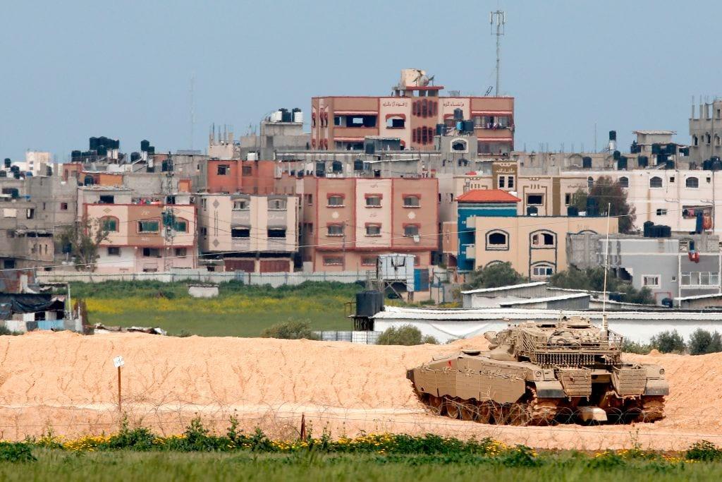 An Israeli Merkava battle tank near the border with the Gaza Strip near the Kibbutz of Nahal Oz [JACK GUEZ/AFP/Getty Images]