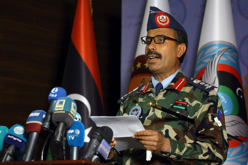 Spokesman for the Libyan forces of the Government of National Accord (GNA) Mohamed Gnounou holds a press conference in the capital Tripoli on 9 April , 2019 [MAHMUD TURKIA/AFP/Getty Images]
