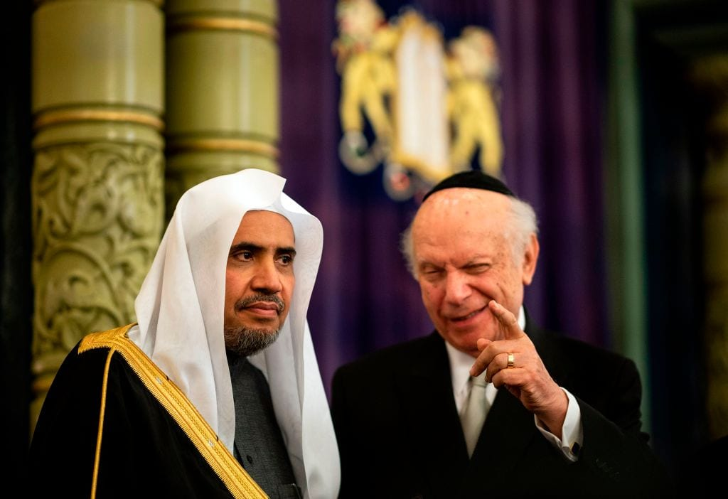 Conscience Foundation President and Founder Rabbi Arthur Schneier (R) and Muslim World League Secretary General Mohammad Abdulkarim Al-Issa speak during an event before signing an agreement calling for the 'protection of religious sites across the world' on 29 April, 2019 [JOHANNES EISELE/AFP/Getty Images]