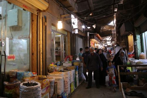 Iraqis shop food products ahead of the Muslim fasting month of Ramadan at the Sadriya market in the capital Baghdad on May 5, 2019. [SABAH ARAR / AFP / Getty]