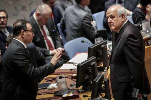 (L to R) Ambassador of Kuwait to the United Nations Mansour Al-Otaibi talks to Permanent Observer of Palestine to the United Nations Riyad Mansour at the start of a UN Security Council meeting concerning the violence at the border of Israel and the Gaza Strip, at United Nations headquarters, May 15, 2018 in New York City. [Drew Angerer/Getty Images]