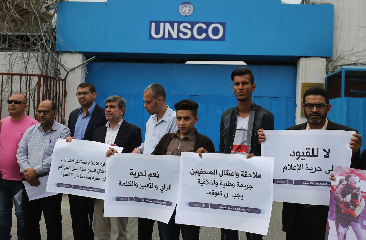 "Palestinian journalists take part in a protest marking the World Press Freedom Day, in front of the headquarter United Nation ""UNSCO"", in Gaza City on 2 May 2019. [Ashraf Amra]"