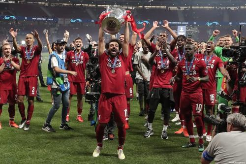 Mohamed Salah of Liverpool lifts the Champions League Trophy after winning the UEFA Champions League Final between Tottenham Hotspur and Liverpool at the Wanda Metropolitano in Madrid, Spain on 1 June 2019. [Burak Akbulut - Anadolu Agency]