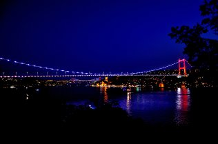 Fatih Sultan Mehmet Bridge and July 15 Martyrs' Bridge are illuminated in colors of flag of Turkey in support of Turkey National Team ahead of a UEFA European Qualifying Group H away match against Iceland on 11 June, 2019 in Istanbul, Turkey [Muhammed Gencebay Gür/Anadolu Agency]
