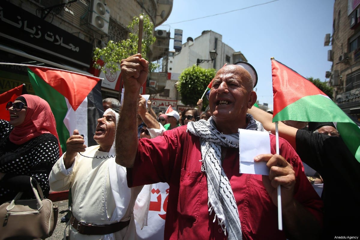 "Palestinians shout slogans as they gather to protest against a conference, scheduled for June 25 and 26, in Bahrain's capital Manama, related to Trump's ""Deal of the Century"" plan in Ramallah, West Bank on June 15, 2019 [Issam Rimawi / Anadolu Agency]"