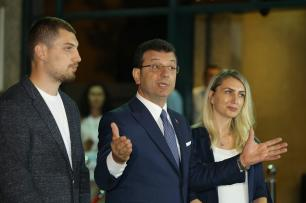ISTANBUL, TURKEY - JUNE 16: Istanbul mayoral candidate of main opposition Republican People's Party (CHP), Ekrem Imamoglu (2nd R) along with his wife Dilek Imamoglu (R) and his son Selim Imamoglu (L) speaks to the press after the live televised debate at Istanbul's Lutfi Kirdar Congress Center, on June 16, 2019 in Istanbul, Turkey. ( Orhan Akkanat - Anadolu Agency )