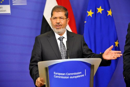 The late former Egyptian President Mohamed Morsi speaking at a press conference in Brussels, Belgium on 13 September 2012 [Dursun Aydemir/Anadolu Agency]