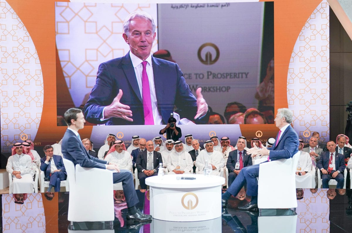 Former British Prime Minister Tony Blair (R) and Jared Kushner (L), U.S. President Donald Trump's senior White House adviser and son-in-law attend U.S.-led workshop in Manama, Bahrain on June 26, 2019. [BNA - Pool - Anadolu Agency]