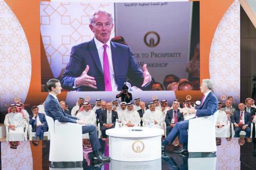 Former British Prime Minister Tony Blair (R) and Jared Kushner (L), U.S. President Donald Trump's senior White House adviser and son-in-law attend U.S.-led workshop in Manama, Bahrain on June 26, 2019. [BNA - Pool - Anadolu Agency]