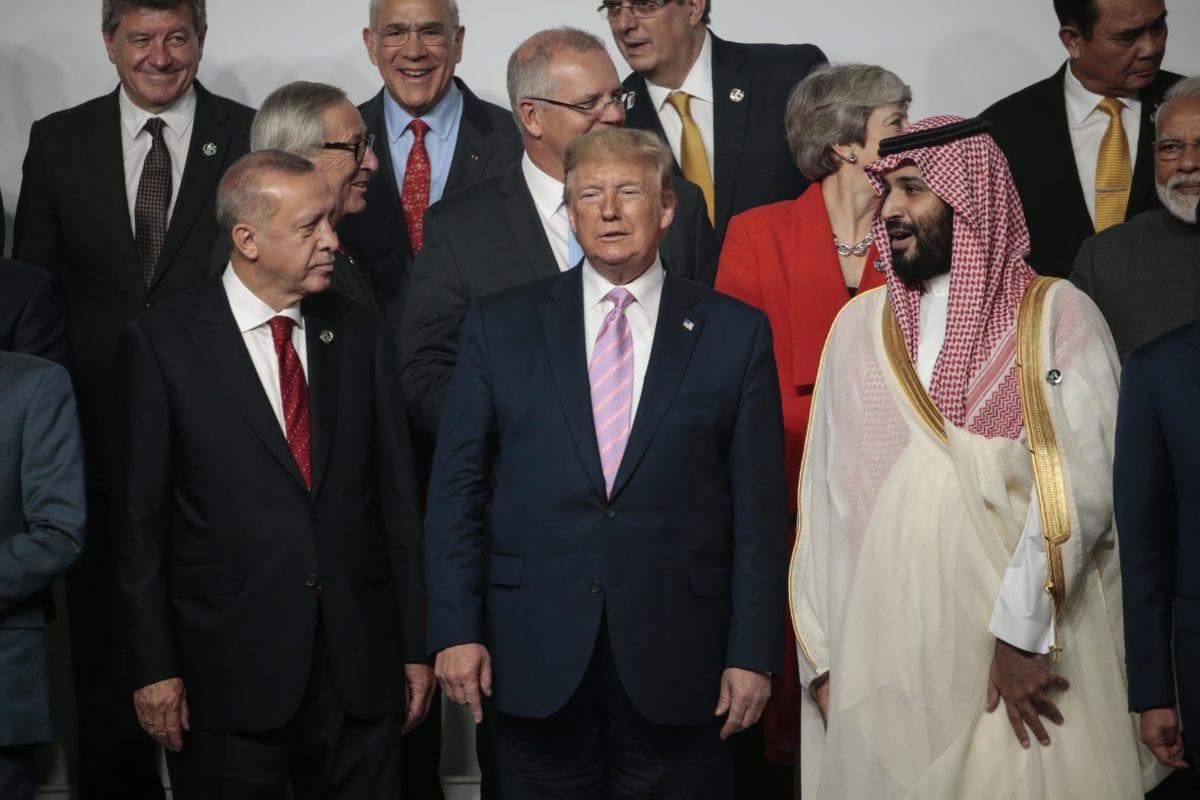 Turkish President Recep Tayyip Erdogan (L), US President Donald Trump (C) and Crown Prince of Saudi Arabia Mohammad Bin Salman (R) pose for the family photo on the first day of the G20 summit in Osaka, Japan on 28 June 2019. [Metin Aktas - Anadolu Agency]