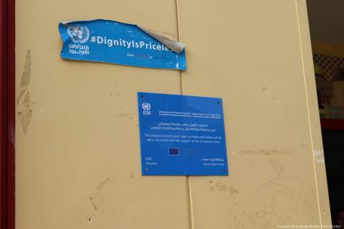 "#DignityIsPriceless"" UNRWA campaign sticker."