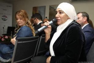 A participant asks a question at the Arab-British Chamber of Commerce for Palestine Entrepreneurship Day in London, UK on 14 June 2019 [Jehan Alfarra/Middle East Monitor]
