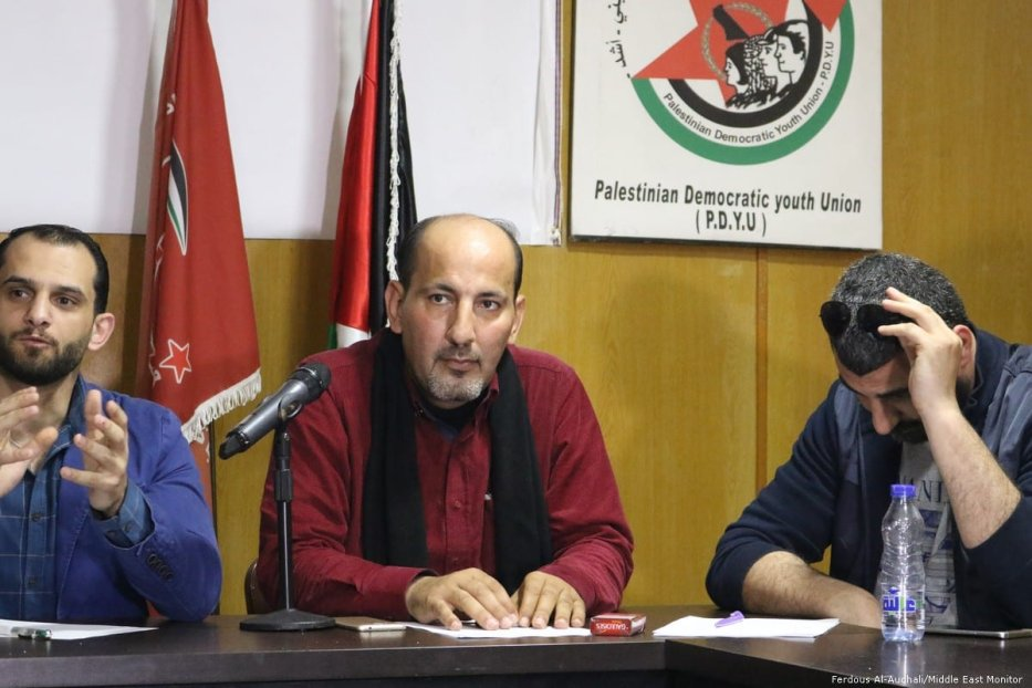 President of the Palestinian Democratic Youth Union, Yusuf Ahmed (centre).