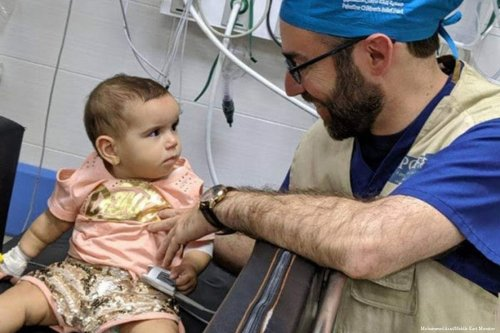 A doctor belonging to the American medical team that succeeded in removing a bullet from head of 7-month-old Palestinian infant who was shot by Israeli fire while in the lap of her mother